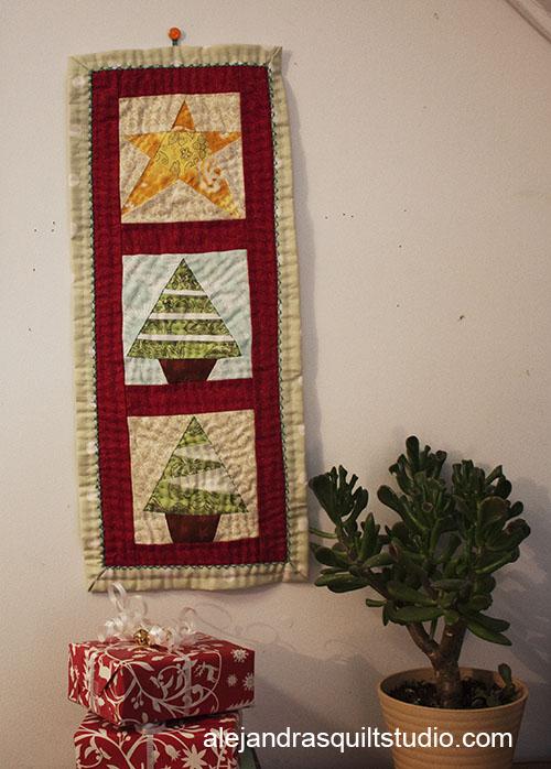 Mini colcha de patchwork navideña