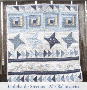 colcha de patchwork con sirenas y bordado